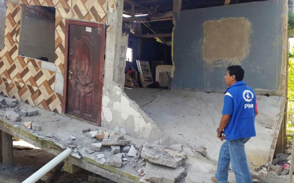 Plan International staff member assessing the earthquake damage in Manabi province.