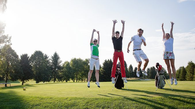 Young people playing golf at a golf club