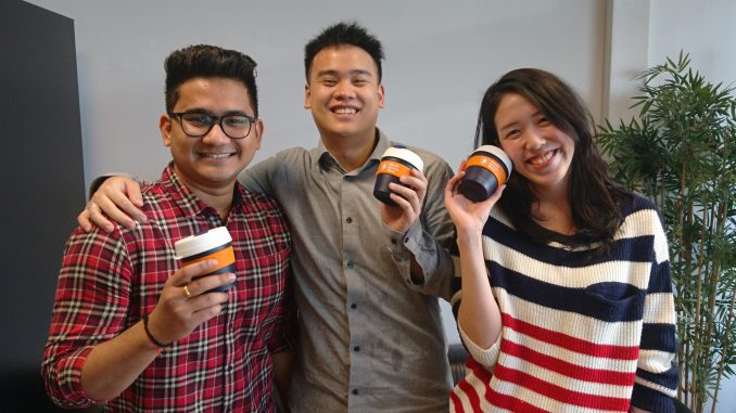 MBS students proudly presenting their new reusable coffee cup