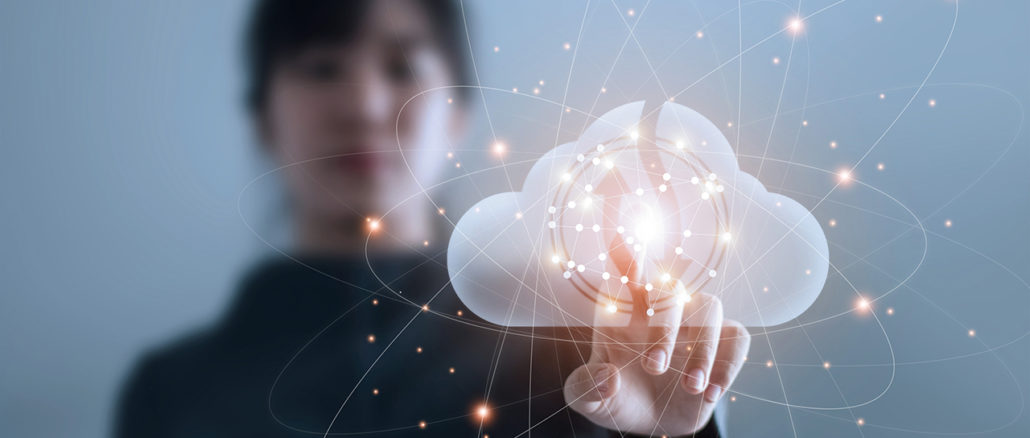 Businesswoman maintaining contact with data via cloud computing networks.