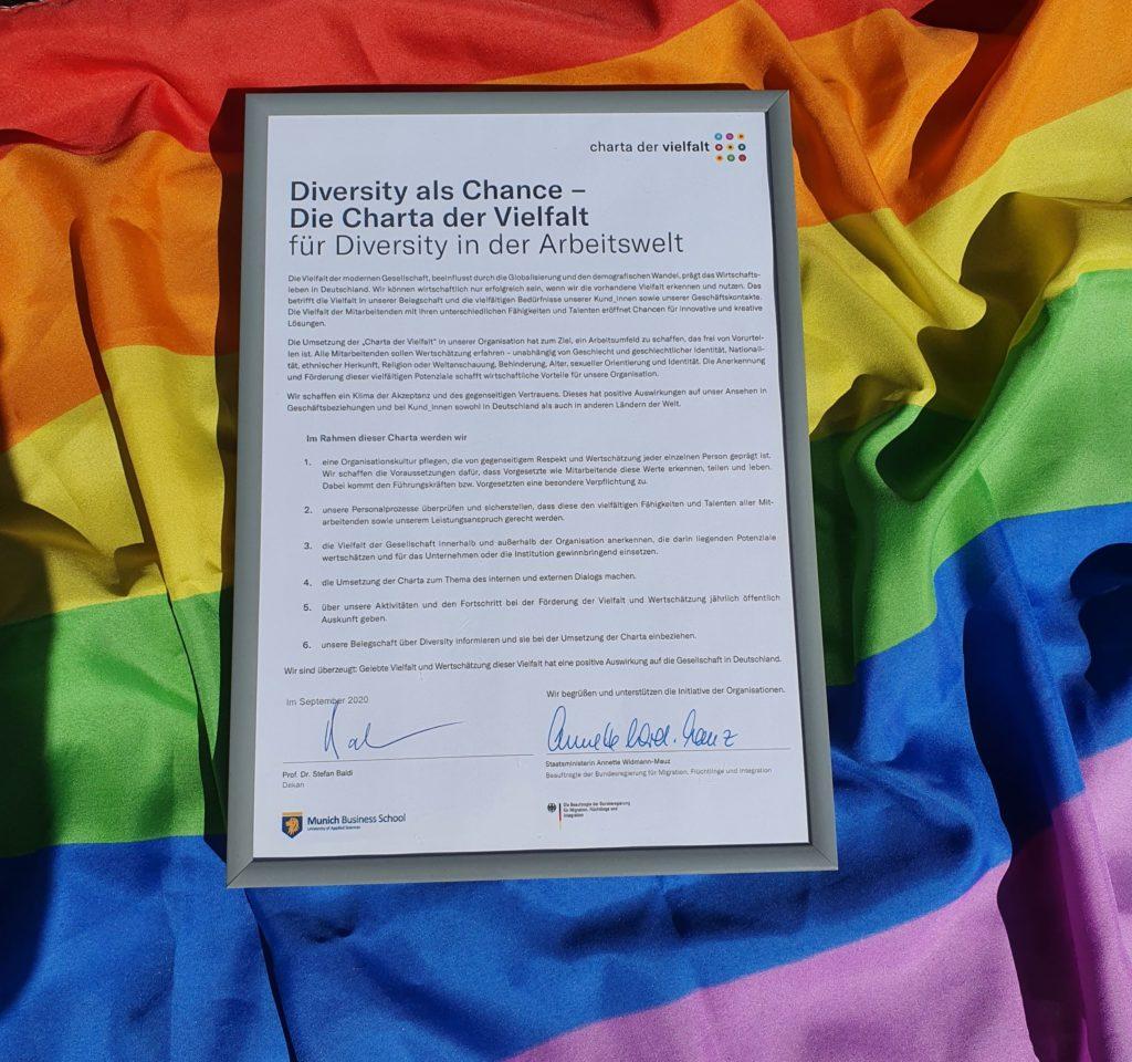 Signed Diversity CharterSigned Diversity Charter lying on a pride flag