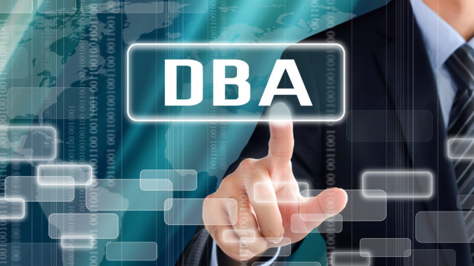 Businessman touching a sign with DBA lettering