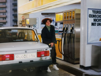 Jana Ribisch with her Wartburg car at the gas station