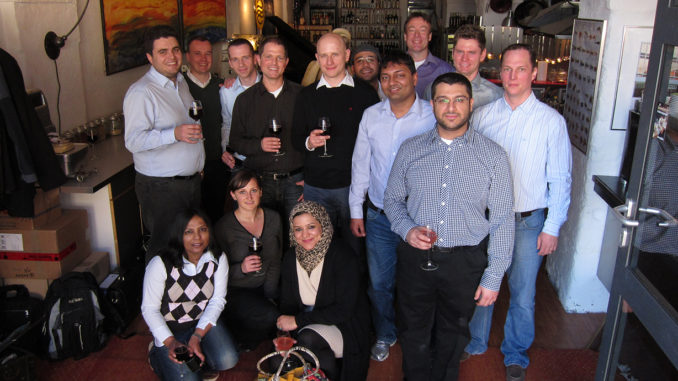Group photo of MBA cohort at cooking class team building event